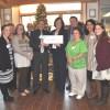 Littauer presents check to Make-A-Wish Northeast New York