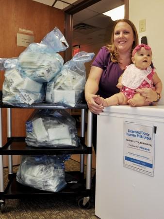 Littauer Radiologic Technologist, Amanda Fosman with infant daughter Aria, donates excess breastmilk to Littauer's Milk Depot