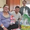 - Meagan Fleaszar and Austin Syzdek with newborn daughter Sophia Syzdek, and Jean LaPorta, President, Friends of the Gloversville Public Library